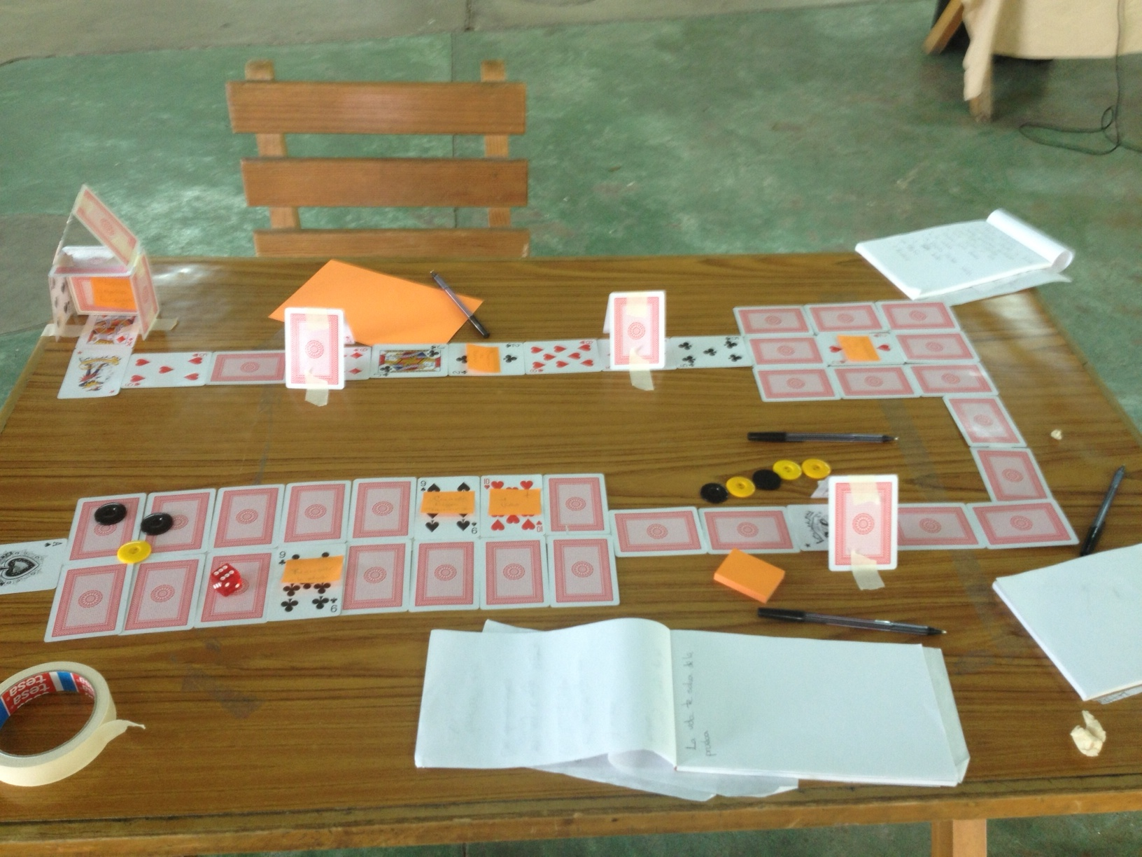 An early prototype repurposing a deck of cards as a shifting game board